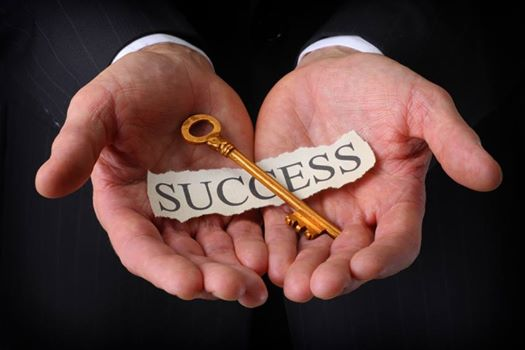 hands-holding-the-keys-to-success
